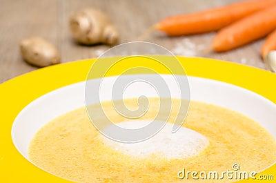 Foam of coconut milk on a carrot soup
