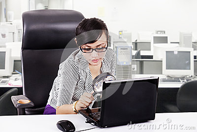 Focus business woman using magnifying glass