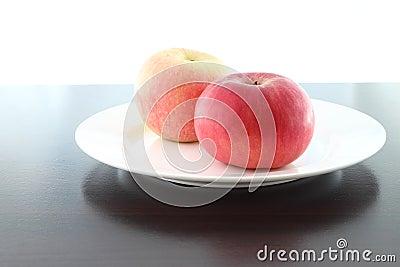 Focus red near apple dish