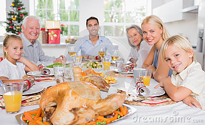 Focus on the roast turkey in front of family