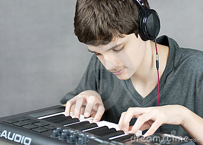 Focused Teen Plays Keyboard