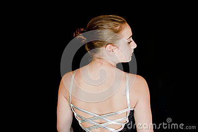 Focused young ballerina backstage
