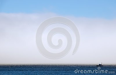 Fog bank and commercial fishing boat