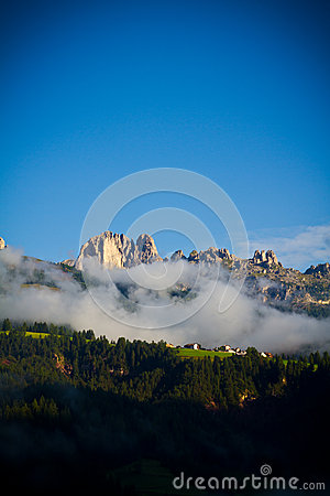 Fog in Dolomites mountains, Italy