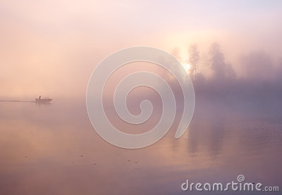Fog fishing boat lake