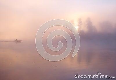 Fog fishing boat lake