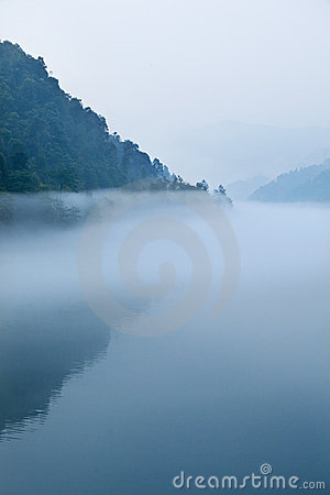 Fog and lake and  mountain in morning