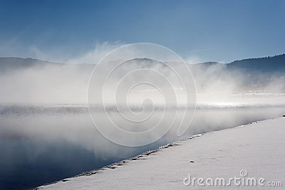 Fog over lake in winter