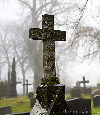 Foggy autum graveyard cross 3