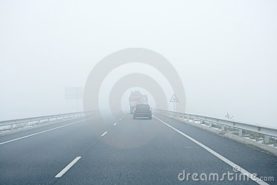 Foggy Gray Road, Cars Driving Into The Fog Stock Photography - Image: 10536652