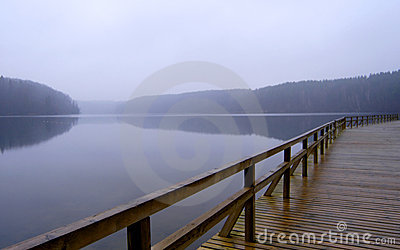 Foggy lake and pier