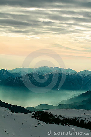 Free Foggy Mountain Scenery At Sunset Royalty Free Stock Photography - 8305377