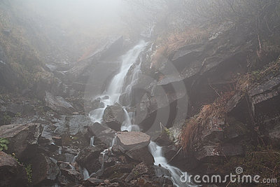 Foggy mystery waterfall
