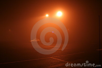 Foggy night-time parking lot