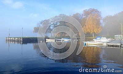 Foggy small boats harbor