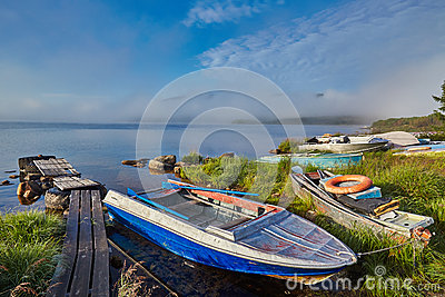 Foggy summer morning on island. A mooring. Jack London s lake. Kolyma