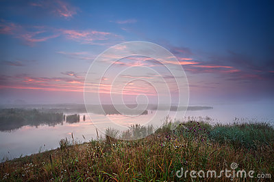 Foggy sunrise over river