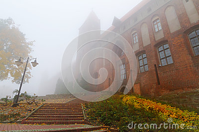 Foggy weather at Kwidzyn castle and cathedral