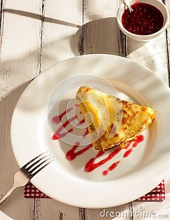 Folded pancake on white plate