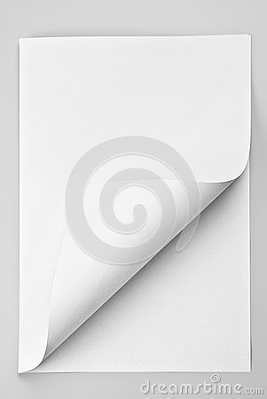 Folded sheet of paper with curled corner