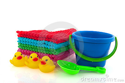 Folded towels and child play set