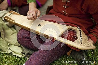 Folk musician with gusli