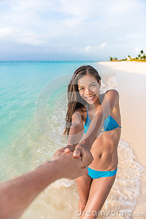 Free Follow Me Girlfriend Leading Man Holding Hand Stock Images - 70049354