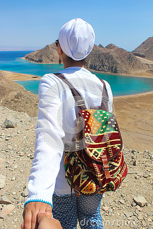 Free Follow Me To The Sea, A Woman With A Colorful Backbag Heading To The Sea With Mountains Stock Photos - 74803623