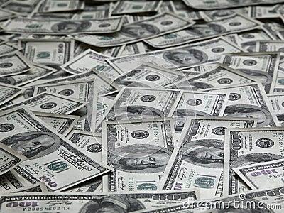 Fondo con las porciones de billetes de dólar del americano ciento