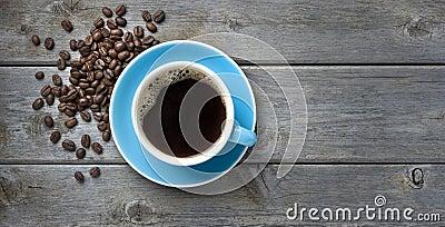 Fondo de las habas de la taza de café