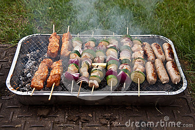 Food cooking on barbecue