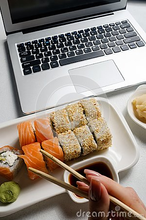 Free Food Delivery Service Sushi Rolls Online Order Royalty Free Stock Photography - 114575687