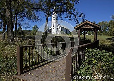 Foot bridge and White Church.