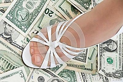 Foot on cash