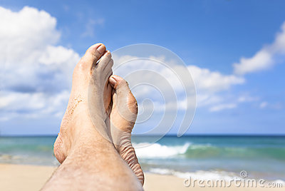 Foot lying on the beach