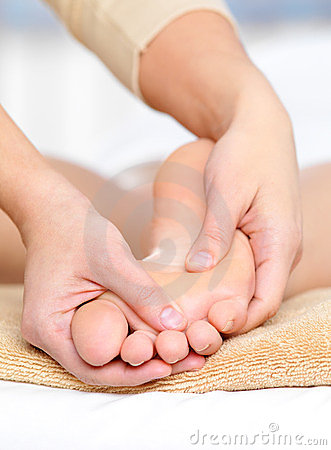Foot massage in spa salon
