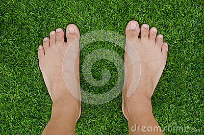 Foot over green grass
