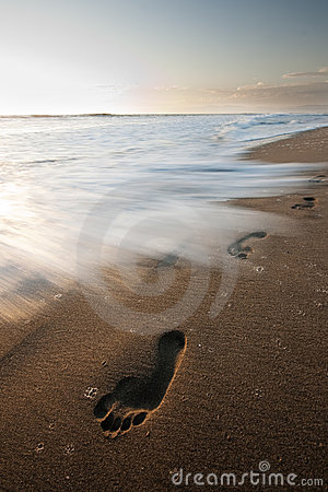 Free Foot Prints In The Sand About To Be Washed Away Stock Images - 16308634
