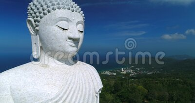 Footage Aerial view Big Buddha of Phuket Thailand. Blue sky and blue ocean are on the back of Big Buddha white statue.Big Buddha Phuket is the one of landmarks stock footage