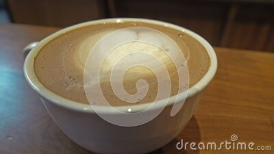 Cup Of Coffee with simple Latte art Closeup. A footage of a cup of coffee with simple latte art close up stock footage