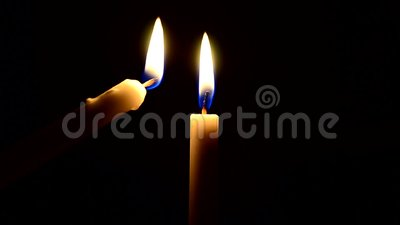 Footage of lighting candle stock video footage