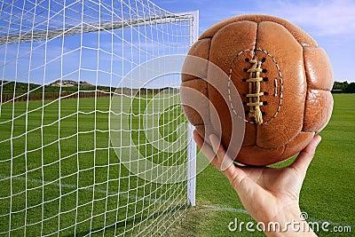Football ball in hand net soccer goal