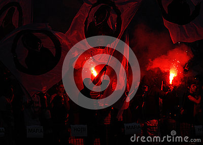 Football fans with flares Editorial Stock Image