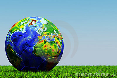 Football with globe texture on grass