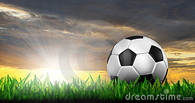 Football in green grass Stock Photo