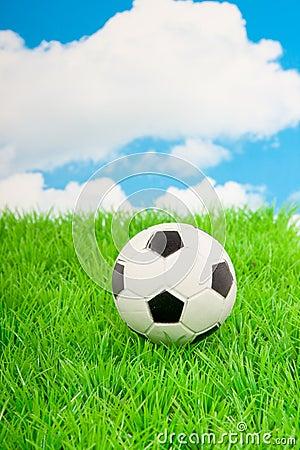 A football on a green lawn