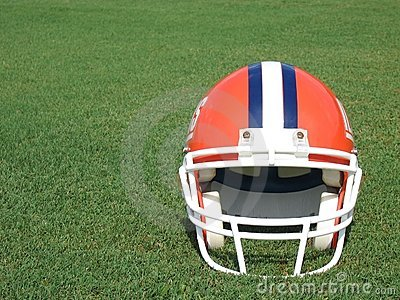 Football Helmet on Grass Field