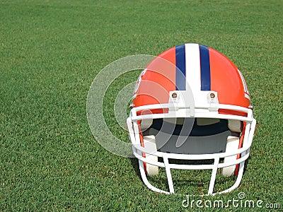 Football Helmet on Grass Field