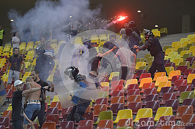 Football hooligans fight against constabulary forces Editorial Stock Image