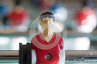 Football player in Foosball bar